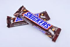 Chocolate bar snickers on a white background Royalty Free Stock Photo