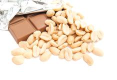 Chocolate bar and some peanuts Stock Image