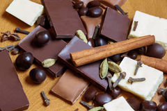 Chocolate bar and spices on wooden table. Selective focus Stock Photography
