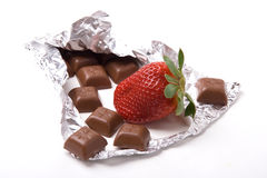 Chocolate bar and strawberry. A photo of a fresh red chocolate with little chocolate bars Stock Photos