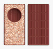 Chocolate bar on white. Chocolate bar in ornamental wrapper and unpacked on white Royalty Free Stock Photos
