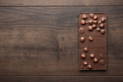 Chocolate bar with whole hazelnuts Royalty Free Stock Images