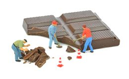 Chocolate Bar and Workmen Stock Photos