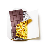 Chocolate bar. Wrapped in foil with open cardboard on white background Stock Photos