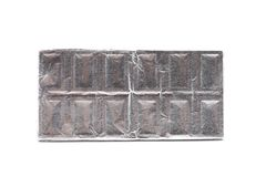 Chocolate bar wrapped in foil. Royalty Free Stock Photography