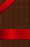 Chocolate bar wrapped in red silk banner Royalty Free Stock Photography