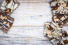 Chocolate bark on wood background Stock Photo