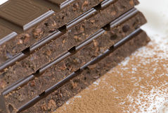 Chocolate bars. With some cacaopowder around Royalty Free Stock Photos