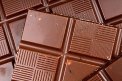 Chocolate bars as background. Milk and dark shiny chocolate texture. Stack chocolates pattern. Stunning beautiful cacao Stock Photo