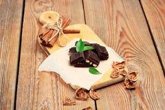 Chocolate bars with cinnamon and walnuts Stock Photos
