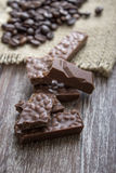 Chocolate bars and coffee beans  on wooden table Stock Images