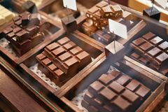 Chocolate Bars In Confectionery Shop Closeup. Handmade Chocolate On Wooden Showcase In Workshop. High Resolution royalty free stock images