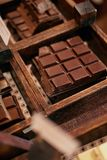 Chocolate Bars In Confectionery Shop Closeup. Handmade Chocolate On Wooden Showcase In Workshop. High Resolution stock images