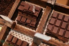 Chocolate Bars In Confectionery Shop Closeup. Handmade Chocolate On Wooden Showcase In Workshop. High Resolution stock photo