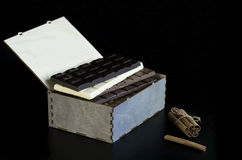 Chocolate bars in a gift box. On a black background royalty free stock photos