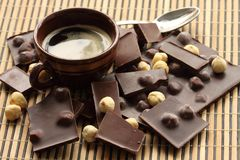 Chocolate bars with hazelnut. Cup of coffee and chocolate bars with hazelnut Stock Images