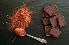 Chocolate bars with heap of cacao powder Royalty Free Stock Image