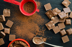 Chocolate bars with heap of cacao powder Stock Image