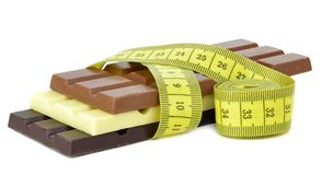 Chocolate bars with a measuring tape Royalty Free Stock Images