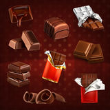 Chocolate bars and pieces. Set with chocolate bars and pieces, vector icons on dark Stock Photography