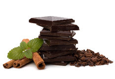 Chocolate bars stack and cinnamon sticks Royalty Free Stock Images