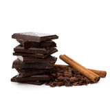 Chocolate bars stack and cinnamon sticks Royalty Free Stock Photo