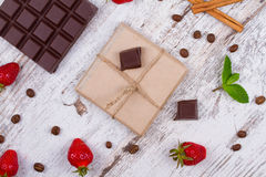 Chocolate bars and strawberries Royalty Free Stock Images