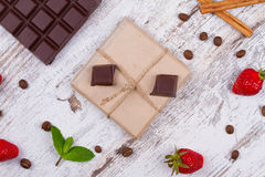 Chocolate bars and strawberries Stock Photography