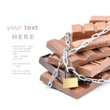 Chocolate bars tied up with chains Royalty Free Stock Image