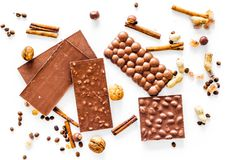 Chocolate bars on white background top view Stock Photo