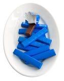 Chocolate bars on white dish. Stock Photo
