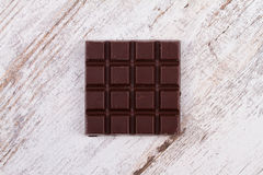 Chocolate bars on white wooden background Stock Photo