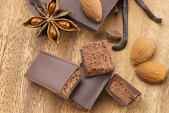 Chocolate bars. On wooden background Stock Photography