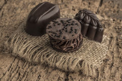 Chocolate bars on wooden table. Some chocolate bars on wooden table Royalty Free Stock Image