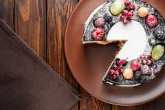 Chocolate berry cake on plate over brown wooden background Stock Image