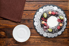 Chocolate berry cake on plate over brown wooden background Stock Images