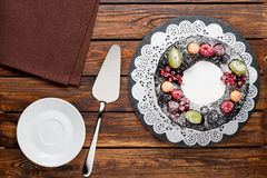 Chocolate berry cake on plate over brown wooden background Royalty Free Stock Photo