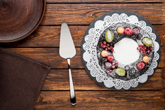 Chocolate berry cake on plate over brown wooden background Royalty Free Stock Image