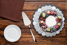 Chocolate berry cake on plate over brown wooden background Stock Photo
