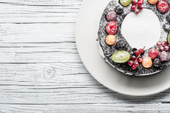chocolate berry cake on plate over white wooden background Stock Photo