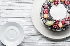 Chocolate berry cake on plate over white wooden background Stock Images
