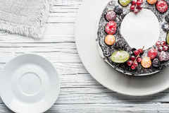chocolate berry cake on plate over white wooden background Royalty Free Stock Images