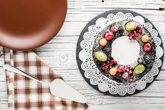 Chocolate berry cake on plate over white wooden background Stock Photography