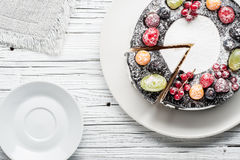 Chocolate berry cake on plate over white wooden background Stock Image