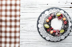 Chocolate berry cake on plate over white wooden background Royalty Free Stock Photos