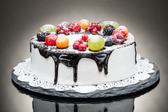 Chocolate berry cake on stone plate over black background Royalty Free Stock Image