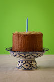 Chocolate Birthday Cake With Almond Flakes And Candle Stock Image