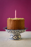 Chocolate Birthday Cake With Almond Flakes And Candle Royalty Free Stock Images