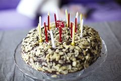 Chocolate birthday cake with almonds and candles Royalty Free Stock Photography