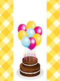 Chocolate birthday cake and balloons Stock Photography